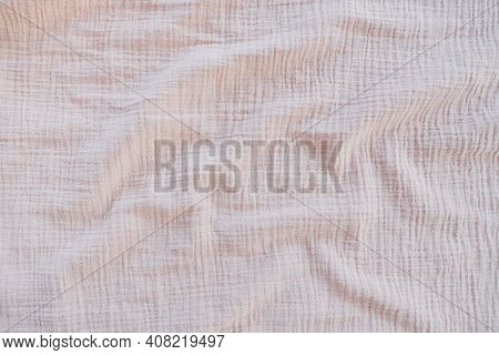 Muslin Cloth Texture Background In Neutral Tones. Muslin Cotton Fabric Of Plain Weave. Muslin Is A S