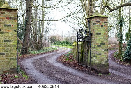 Old Open Gate Of Country Estate With Iron Antique Gate. Road Leading To Estate, Park, Property