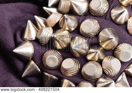 Metallic Triangles Cones On The Shoulder Of The Garment. Steampunk Clothing Concept, Close-up, Styli