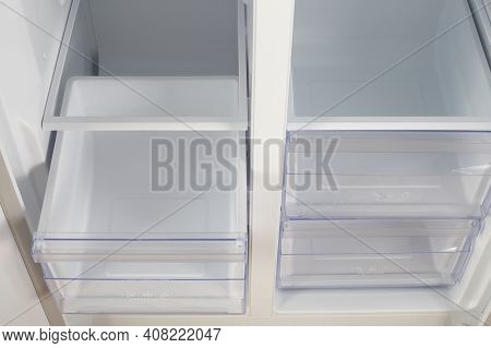 Home Appliance - Inside Closeup Open Two-door White Refrigerator Freeze And Fresh Zone