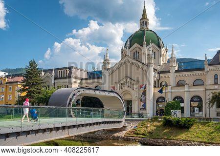 Sarajevo, Bosnia and Herzegovina - August 28, 2019: Academy of Fine Arts and Festina lente bridge over the river Miljacka in Sarajevo, BiH