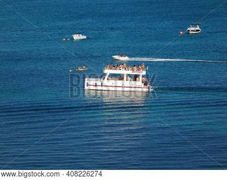 Pleasure Catamaran In The Sea. Aktau. Kazakhstan. 21 July 2019 Year.