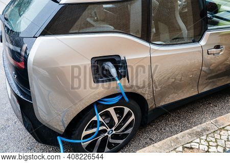 Lisbon, Portugal - Feb 9, 2018: Electric Cars Being Charged At Power Station Bmw Mini Car With Blue