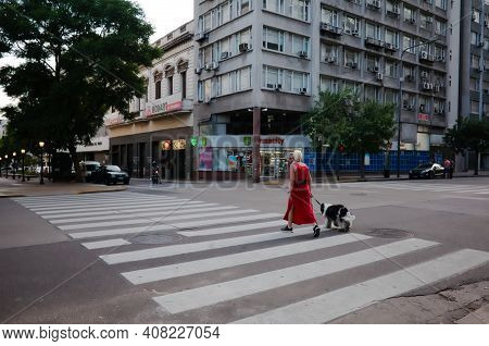 Buenos Aires, Argentina - January, 2020: Woman With Big Dog Crossing Street On Pedestrian Crossing I
