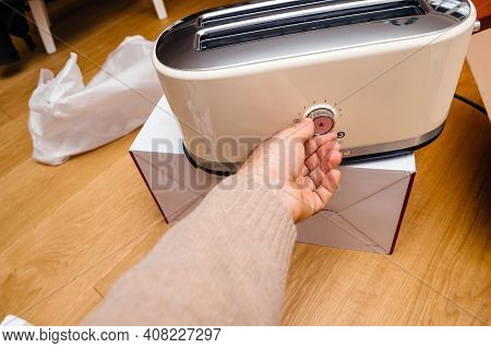 Paris, France - Feb 1, 2021: Overhead View Of Male Hand Touching The Main Control Knob Of Kitchenaid