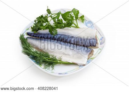 Pickled Mild Salted Fillets Of Atlantic Mackerel With Removerd Skin On A Dish With Twigs Of Fresh Pa