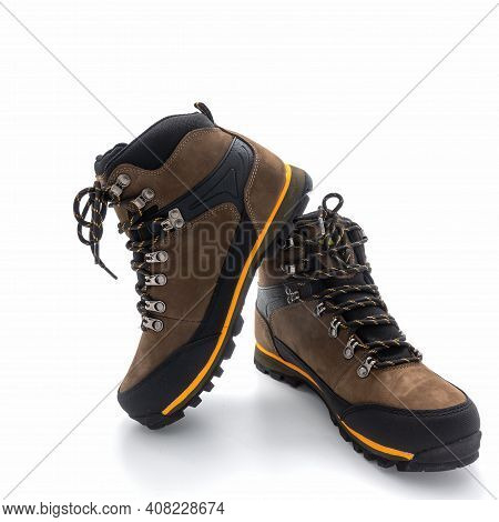 Men's Trekking Boots With Grooved Soles. Made In Brown Nubuck And Black Vinyl. Yellow Finish. Metal