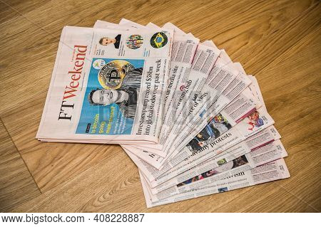Paris, France - Feb 13, 2021: Stack Of Multiple Financial Times Newspaper On Kitchen Counter With El