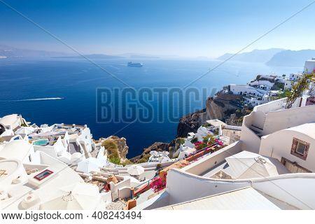 Oia town cityscape at Santorini island in Greece. Traditional white houses. Greece, Aegean sea. Famous European destination
