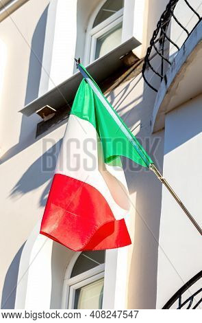 State Flag Of Italy On The Balcony Of The House