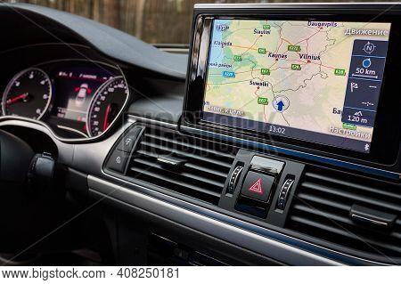Grodno, Belarus - December 2019: Audi A6 4g C7 Interior In Dark Tones With Display With Gps Navigati