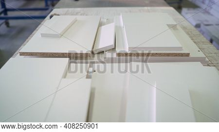 There Is A Stack Of Osb Sheets On The Table. Construction Material. Osb Sheets Are Stacked In A Hard