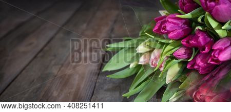 Bunch Purple Tulips On Dark Wooden Vintage Planks. Floristry Background With Short Depth Of Field An
