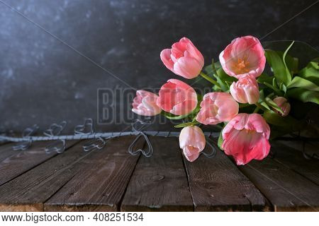 Atmospheric Mothers Day Still Life With Pink Tulips On Dark Vintage Background. Space For Text.