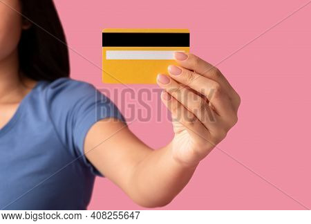 I Choose This Bank. Closeup Of Unrecognizable Woman Holding And Showing Yellow Plastic Debit Credit