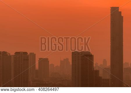 Air Pollution. Smog And Fine Dust Of Pm2.5 Covered City In The Morning With Red Sunrise Sky. Citysca