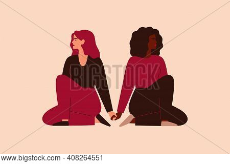 Two Strong Women Sit Together And Hold Arms. Fearless Girls Support And Help Each Other. Friendship