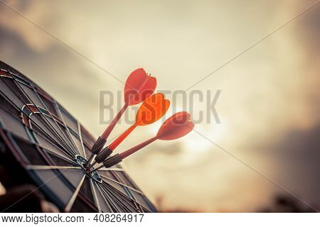 Close Up Shot Of The Dart Arrow Hit On Bulleyes Of Dartboard To Represent That The Business Reached