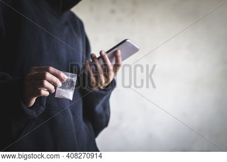 Drug Dealers Use The Phone To Contact The Customer, Drug Trafficking, Crime, Addiction And Sale, The