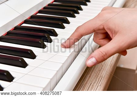 Womans Hands Playing Electronic Digital Piano At Home. The Woman Is Professional Pianist Arranging M
