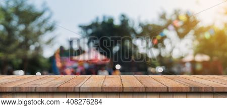 Empty Wood Table And Defocused Bokeh And Blur Background Of Garden Trees In Sunlight, Display Montag