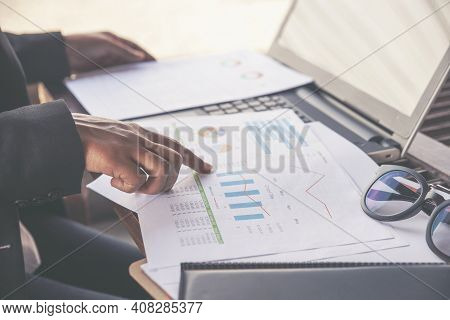 Business And Financial Planning Concept. Hand Of Financial Advisor Planning Budget And Point At Repo