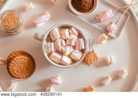 Delicious Sweet Aromatic Cocoa Drink Or Hot Chocolate With Marshmallow Sweets In Mug On White Table.