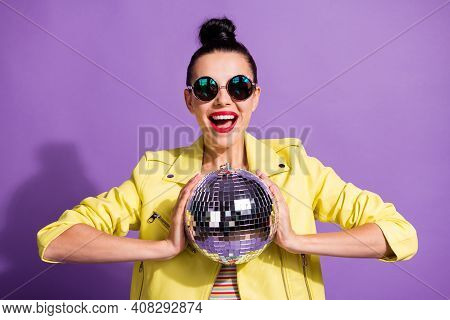 Photo Of Crazy Cool Millennial Girl Hold Glitter Discotheque Ball Scream Isolated Over Purple Color