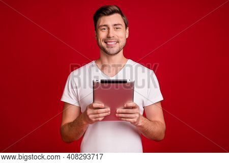 Photo Portrait Of Young Worker Keeping Tablet Working Smiling Isolated Bright Red Color Background