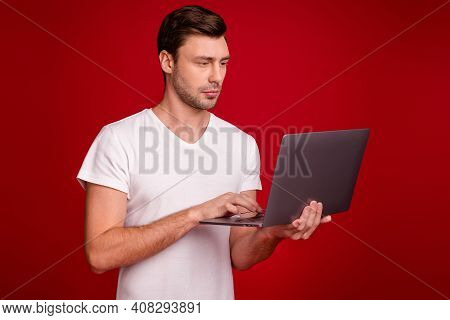 Photo Portrait Of Young Programmer Working With Laptop Concentrated Focused Isolated Vibrant Red Col
