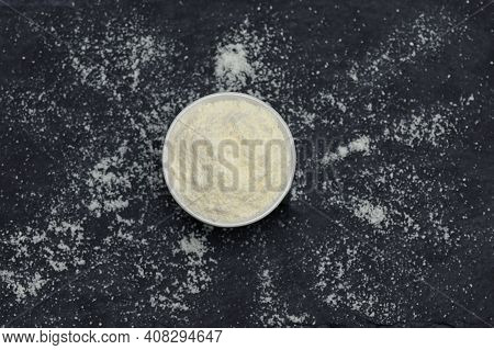 Soy Flour Powder On Ardesia Stone Black Background