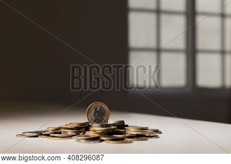 Real Currency, Money From Brazil. Coins Stacked On The Table, With A Coin On Top. Brazilian Economy,