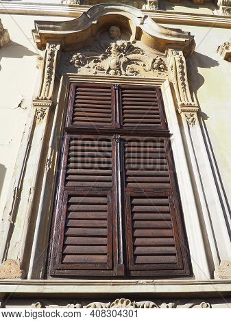 Antique Window With Shutters. An Ornate Stucco Window In A Stone House. Wooden Frame, Venetian - Bro