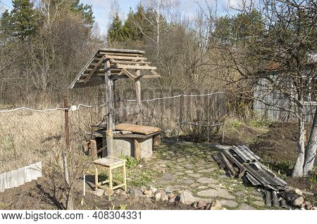 Old Village Well, Repair, Restoration And Cleaning Of A Wooden Well, Services For The Annual Cleanin