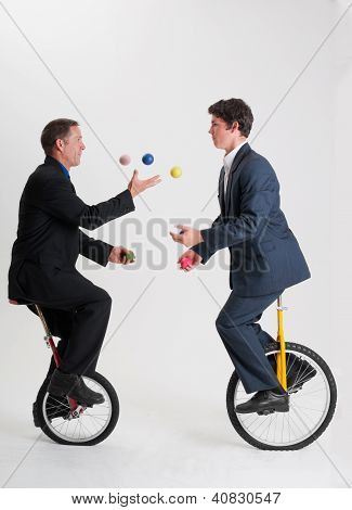 Juggling Businessmen Riding Unicycles