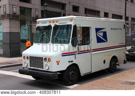 Philadelphia, Usa - June 11, 2013: United States Postal Service Van In Philadelphia. Usps Is The Ope
