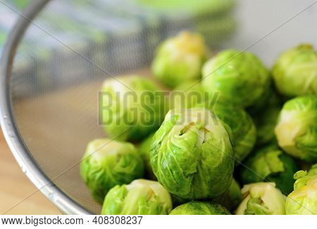Heap Of Fresh Green Brussels Sprouts In Colander.