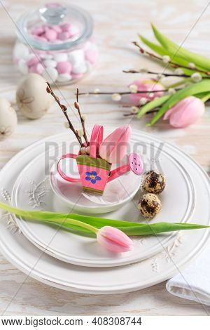 Place setting for Easter table with spring flowers. Easter table decoration.