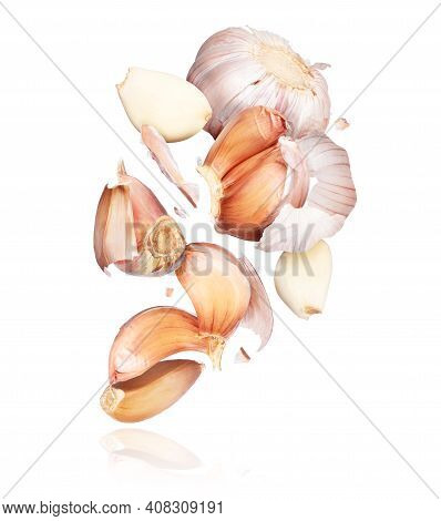 Garlic Unfolds In The Air Close-up, Isolated On White Background