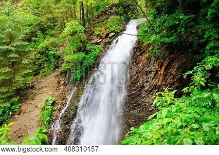 The Guk Waterfall On The Zhenets River In The Carpathians. Waterfall On A Mountain River. Beautiful