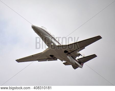 Corporate Business Jet Taking Off Against Overcast Sky