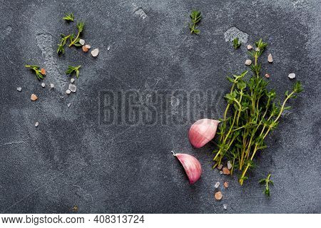 Food Cooking Background. Spices Herbs And Garlic At Black Slate Table. Food Ingredients Top View.