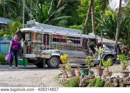 Oslob, Cebu Island, Philippines - October 2, 2018: Jeepney Taxi Stopped On Rural Road. Cheap Public