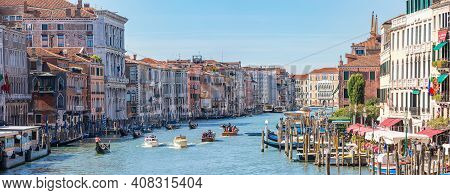 Venice, Italy - August 16, 2018: Amazing View On The Beautiful Canal Grande. Many Gondolas Boats Sai
