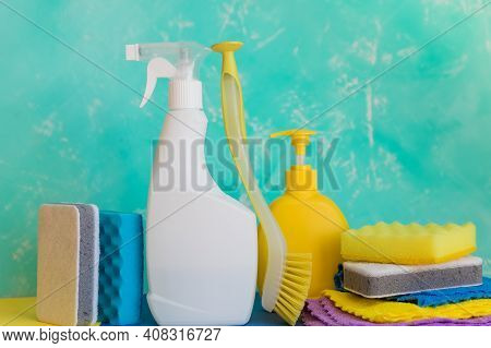Cleaning Product, Household, Sanitary Supplies.variety Of Colorful House Cleaning Products On Blue B