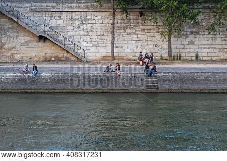 Paris, France, June 22: The Parisians And Visitors Of City Resting On A Hot Sunny Day On The Embankm