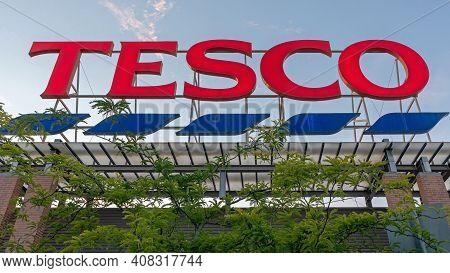 Szeged, Hungary - June 25, 2020: Big Red Sign Tesco At British Supermarket Store.