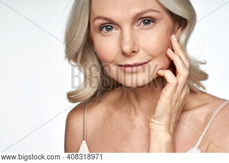 50s Mid Aged Woman Touching Face Skin Looking At Camera. Attractive Mature Old Woman Looking At Came