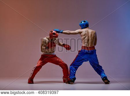 Sparring Of Two Fighting Males In Boxing Gloves During Battle, Martial Arts, Mixed Fight Workout