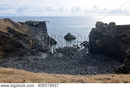 Stunning Black Stone Beach On The Rugged Coastline Of Iceland.